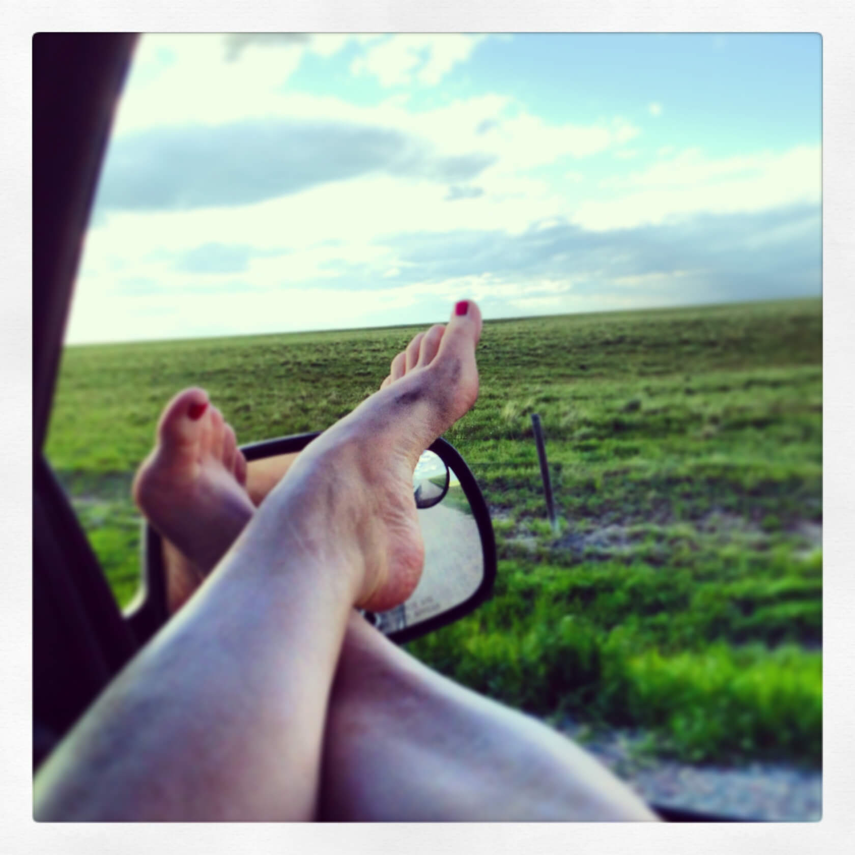 Driving through the country with my feet out the window. Heaven!